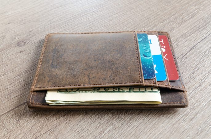 brown-leather-wallet-and-us-dollar-banknote-915915wallet.jpg