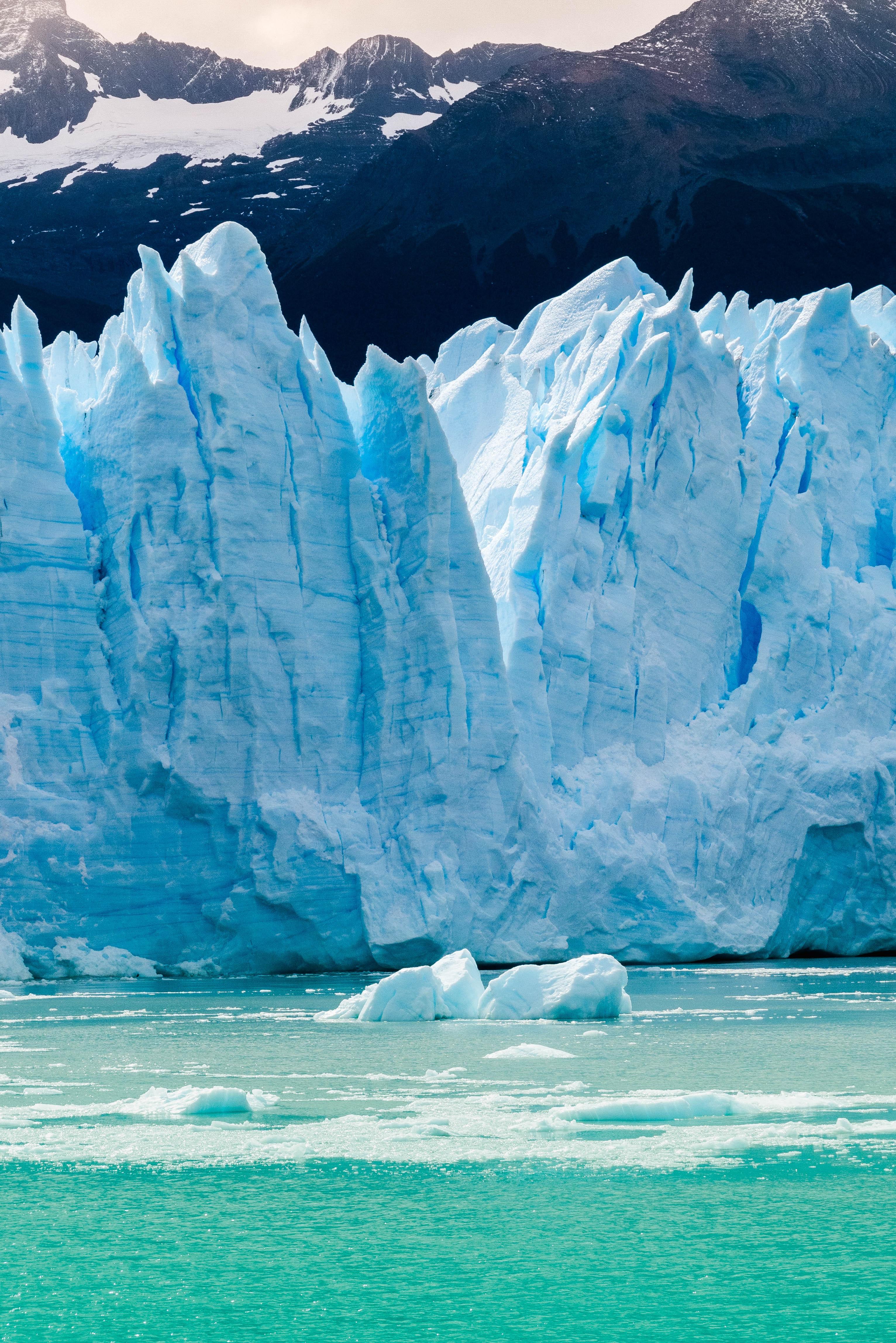 rock-formation-in-winter-near-body-of-water-4042397